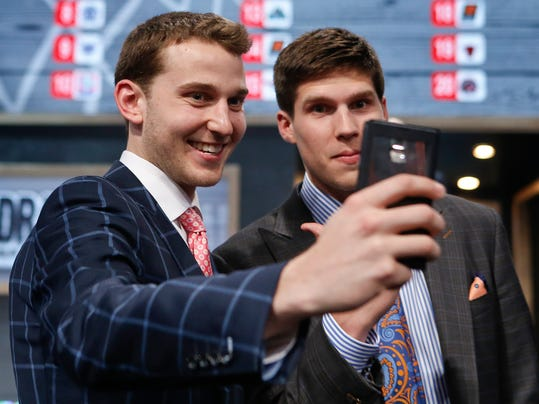 Michigan's Nik Stauskas, left, and Creighton's Doug McDermott pose together for a selfie before the start of the 2014 NBA Draft, Thursday, June 26, 2014, in New York. (AP Photo/Kathy Willens)