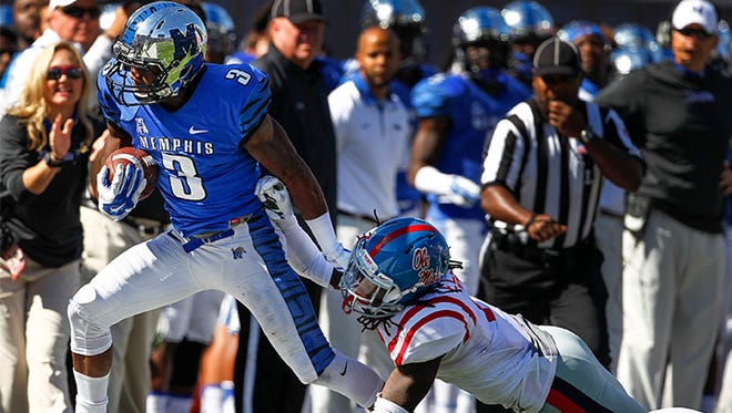 October 17, 2015 - Memphis receiver Anthony Miller (left) fights for a first down against Ole Miss defender Trae Elston (right) during fourth quarter action at Liberty Bowl Memorial Stadium.