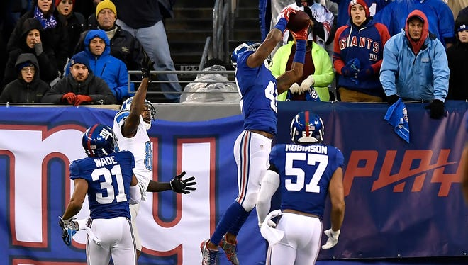 Giants cornerback Dominique Rodgers-Cromartie (41) intercepting a pass intended for Detroit Lions wide receiver Anquan Boldin (80) in the end zone Sunday with 1:58 left in the game.