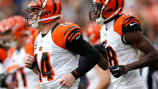 Cincinnati Bengals quarterback Andy Dalton (14), left, and Cincinnati Bengals wide receiver A.J. Green (18), right, run back to the sideline after Green scored a touchdown in the second quarter during the Week 13 NFL game between the Cincinnati Bengals and the Cleveland Browns, Sunday, Dec. 6, 2015, at FirstEnergy Stadium in Cleveland. The Bengals lead 20-3 at halftime.