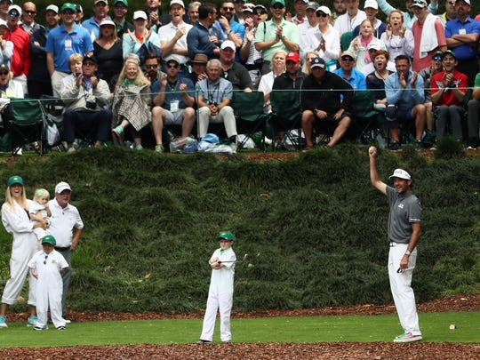 AUGUSTA, GA - APRIL 04:  Bubba Watson of the United States cheers as his guest hits a tee shot on the ninth hole during the Par 3 Contest prior to the start of the 2018 Masters Tournament at Augusta National Golf Club on April 4, 2018 in Augusta, Georgia.  (Photo by Jamie Squire/Getty Images)