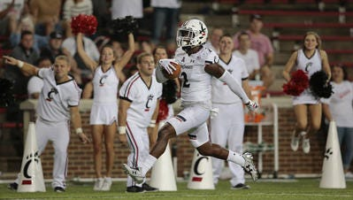 Princeton High School graduate Tyrell Gilbert scores on an interception return in the Cincinnati Bearcats' 28-7 win over UT Martin in the 2016 season opener.