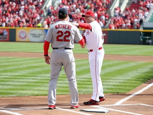 St. Louis Cardinals manager, Mike Matheny, left, and Cincinnati Reds manager Bryan Price shake hands during the pregame ceremonies.