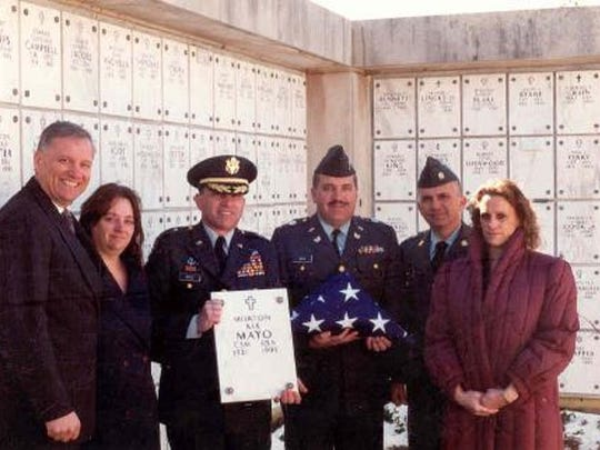 The Mayo siblings at the  interment in the columbarium in Arlington National Cemetery of their mother, Anna Mayo. From left are John Mayo, who was a major; Maureen, who was a sergeant; Maj. Gen. Michael Mayo (retired), who's holding their father's marker; Chief Warrant Officer 5 Robert Mayo (retired); Master Sgt. Patrick Mayo (retired); and Martha.
