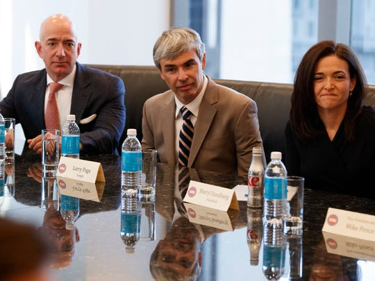 From left, Amazon founder Jeff Bezos, Alphabet CEO Larry Page and Facebook COO Sheryl Sandberg listen as President-elect Donald Trump speaks during a meeting with technology industry leaders at Trump Tower in New York, Wednesday, Dec. 14, 2016.