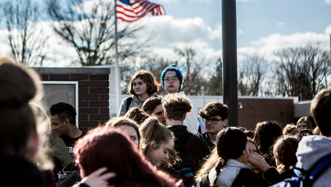 Newark High School students participated in a student led walkout, Wednesday March 14. The walkout honored the 17 killed a month ago at Marjory Stoneman Douglass High School in Florida with 17 minutes of silence.