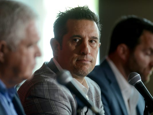 Bob Boughner, center, the new Florida Panthers' coach, listens as Panthers President of Hockey Operations & General Manager Dale Tallon speaks at a press conference Monday, June 12, 2017, in Sunrise, Fla. (Taimy Alvarez/South Florida Sun-Sentinel via AP)