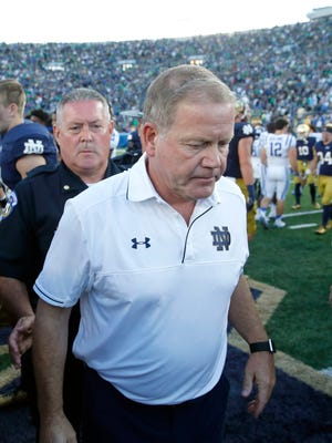 Notre Dame head coach Brian Kelly, right, walks away from Duke head coach David Cutcliffe after their handshake after an NCAA college football game Saturday.