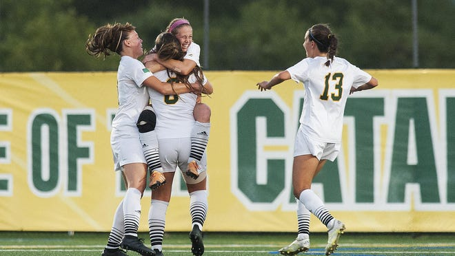 The Catamounts celebrate a goal by Catamount midfielder Brooke Jenkins (11) during the women's soccer game between the Central Connecticut State Blue Devils and the Vermont Catamounts at Virtue Field on Friday night August 26, 2016 in Burlington.