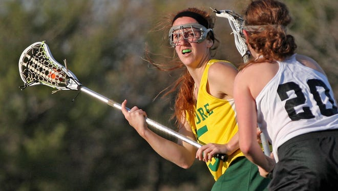 Lady Aves senior Kara Marth, looks for an opening in game action at the Blue Ash Sports Complex, April 10. Sycamore beat Ursuline 15-3, to improve to 3-0.