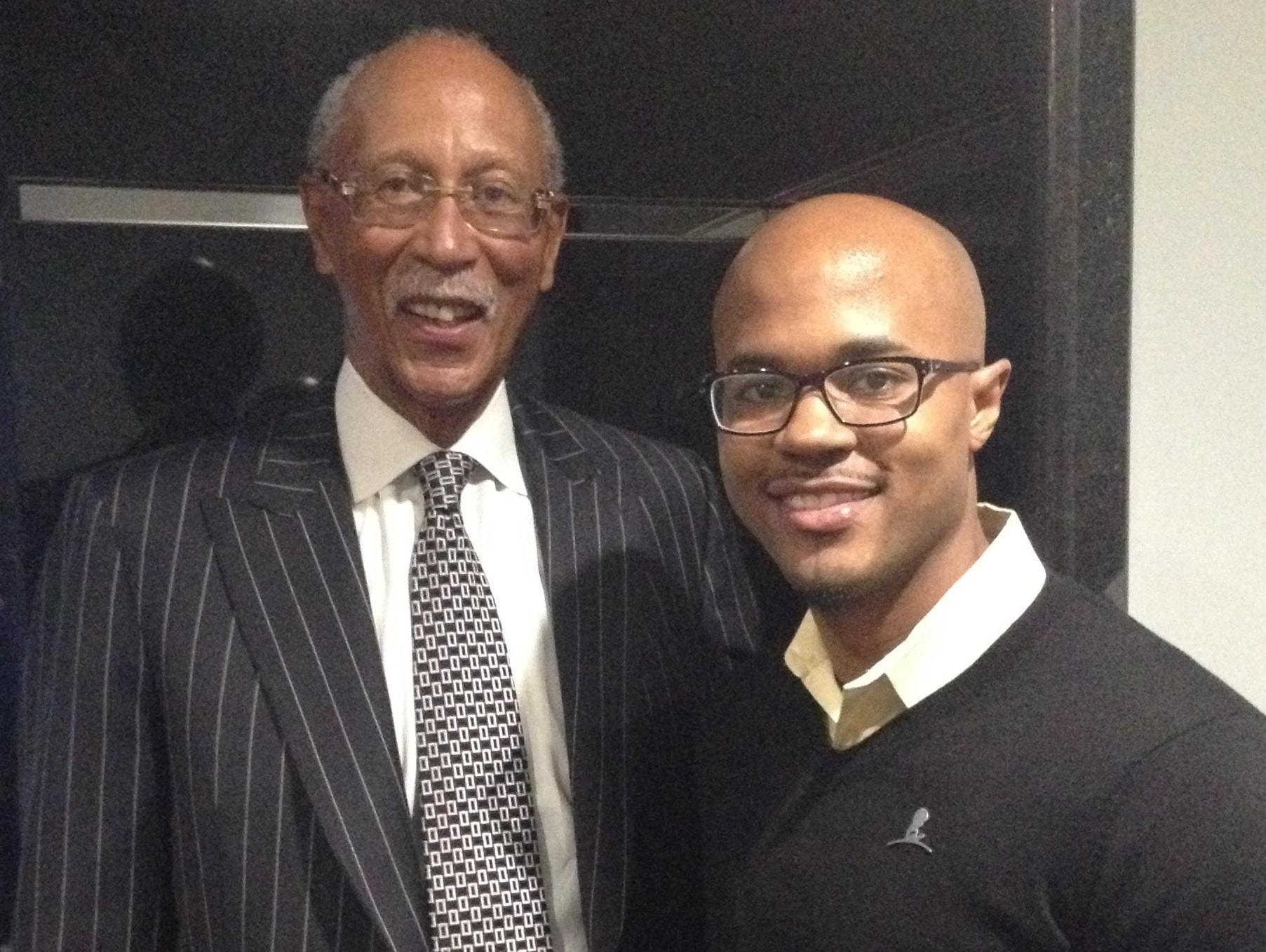 Aaron Smith is pictured with former Detroit Mayor and Pistons great Dave Bing.