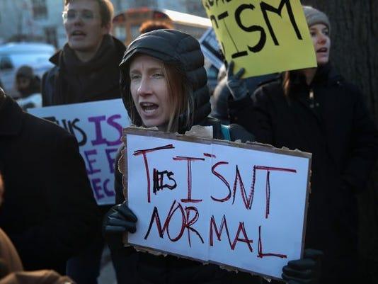 636258740559952155-u-chicago-protest-e1490141948464.jpg