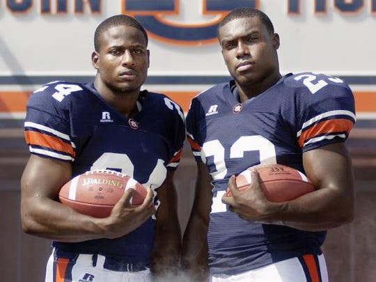 Cadillac Williams, left, and Ronnie Brown combined for 2,078 yards and 20 rushing touchdowns in 2004.