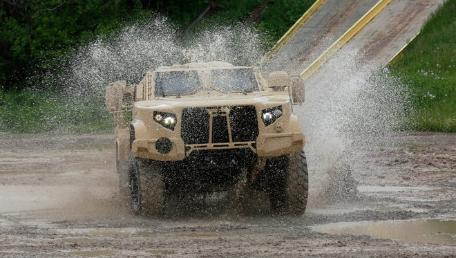 Oshkosh Corp.'s JLTV maneuvers through the test course. The JLTV is in the MATV family of vehicles, but lighter and faster.