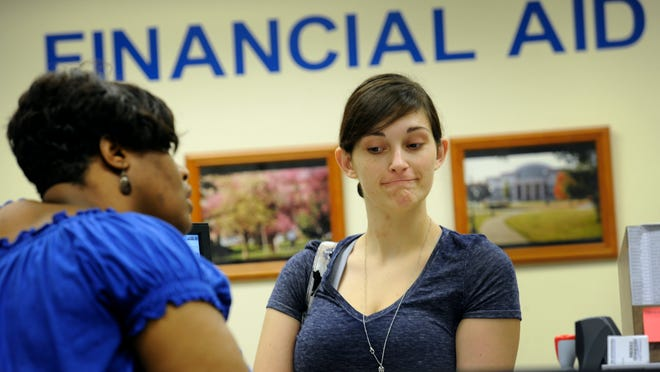 MTSU student Karly Vines listens to advice from financial aid student worker Anika Robinson in July 2013 in Murfreesboro. An economist says higher education institutions will have to be creative in raising money in the future.