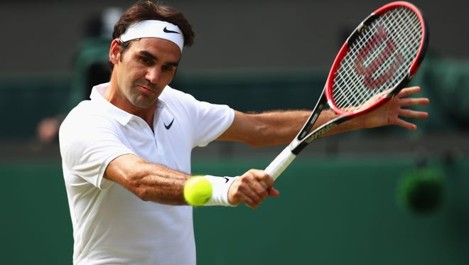 Roger Federer of Switzerland plays a backhand during the quarterfinal match against Marin Cilic of Croatia.