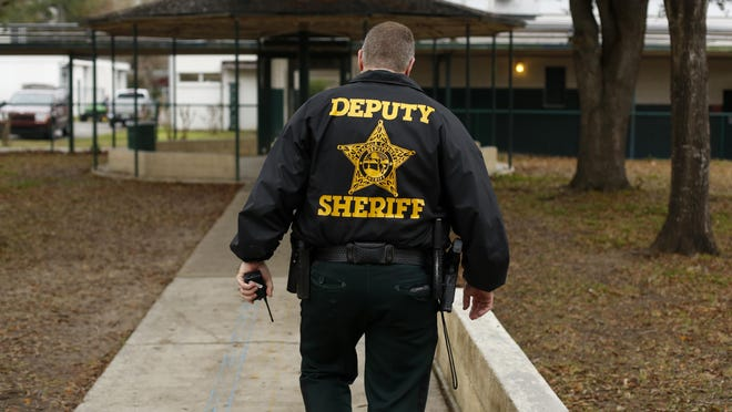 A school resource deputy patrols a Gainesville school.
