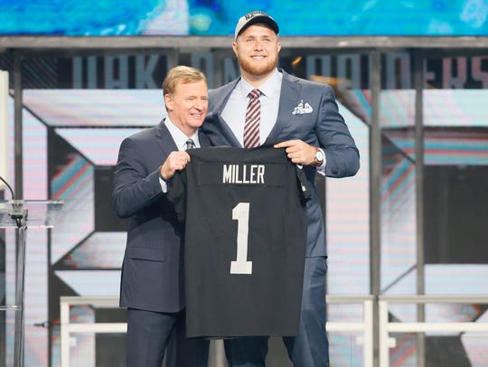 Offensive tackle Kolton Miller with NFL commissioner Roger Goodell after being selected as the No. 15 overall pick to the Oakland Raiders in Thursday's first round of the 2018 NFL Draft at AT&T Stadium.