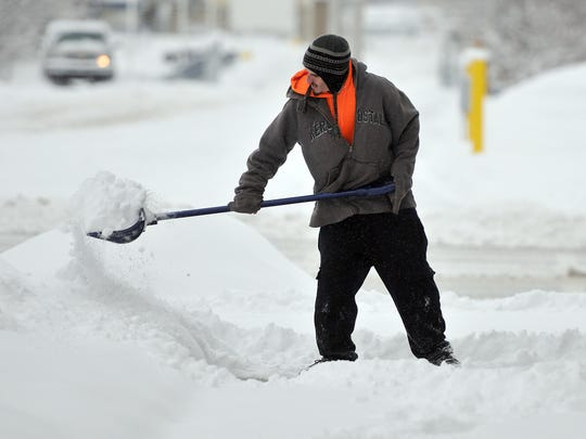 LSJ file photo What happened to the ?refrigernation? forecast for Michigan?s winter? Lansing State Journal file photo If you plan to shoulder all or some of your snow shoveling, take steps to stay healthy. Anthony Magyar shovels snow Sunday in Lansing?s REO Town.   Robert Killips/Lansing State Journal Anthony Magyar shovels snow in Reo Town in this Lansing State Journal photo from 2014.
