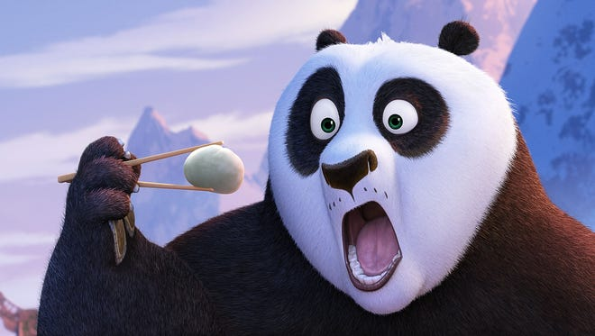 Po (voiced by Jack Black)  inhales a dumpling in 'Kung Fu Panda 3.'