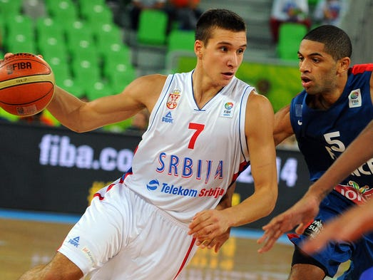 Bogdan Bogdanovic vies with Nicolas Batum of France during a FIBA Eurobasket game between Ukraine and Lithuania on Sept. 15, 2013.