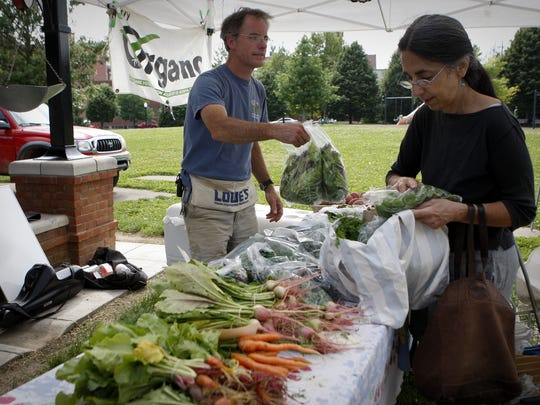 Valerie Chronis buys produce at the Northside Farmers