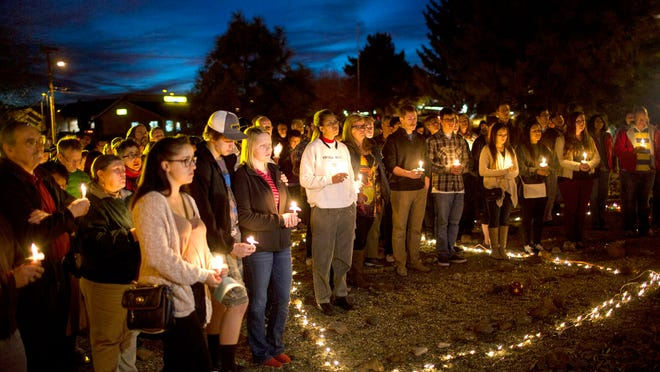 Members of the Flagstaff, Prescott and NAU community gather at a candlelight vigil for Kayla Mueller February 14, 2015 in Flagstaff at the campus church, . she was being held prisoner in by ISIS