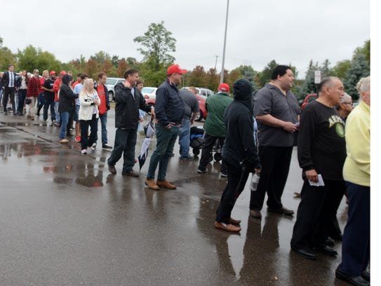 Long lines of fans waited to get inside the Suburban