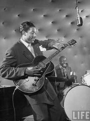 Slim Gaillard was a madly talented guitarist. He is shown her playing at a club in Los Angeles, circa 1946.