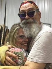 David Powell hugs an emotional Veronica Embry after