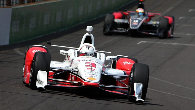 Verizon IndyCar series drivers and teams were able to test the new aero kits on the oval Sunday, May 3, 2015, at the Indianapolis Motor Speedway. Team PenskeÕs Helio Castroneves (3) drives his car into turn one during the afternoon practice.