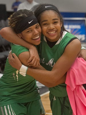 Fort Myers High School's Destanni Henderson (3), left, and Janay Outten (2) celebrate after beating Choctawhatchee in the FHSAA Girls 7-A Championship game at The RP Funding Center in Lakeland Saturday, March 3, 2018. Fort Myers won 65-41.