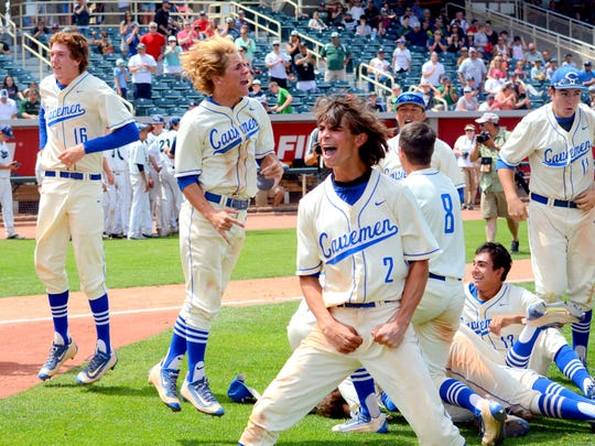 Carlsbad's Ryan Razo (2) celebrates winning the 2016 6A state baseball title Saturday at Isotopes Park in Albuquerque.