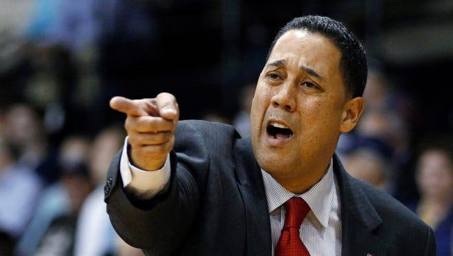 FILE - Ex-Marist coach Chuck Martin yells to his team during the first half of an NCAA college basketball game against Villanova in the NIT Preseason Tip-Off, Nov. 16, 2010, in Villanova, Pa.
