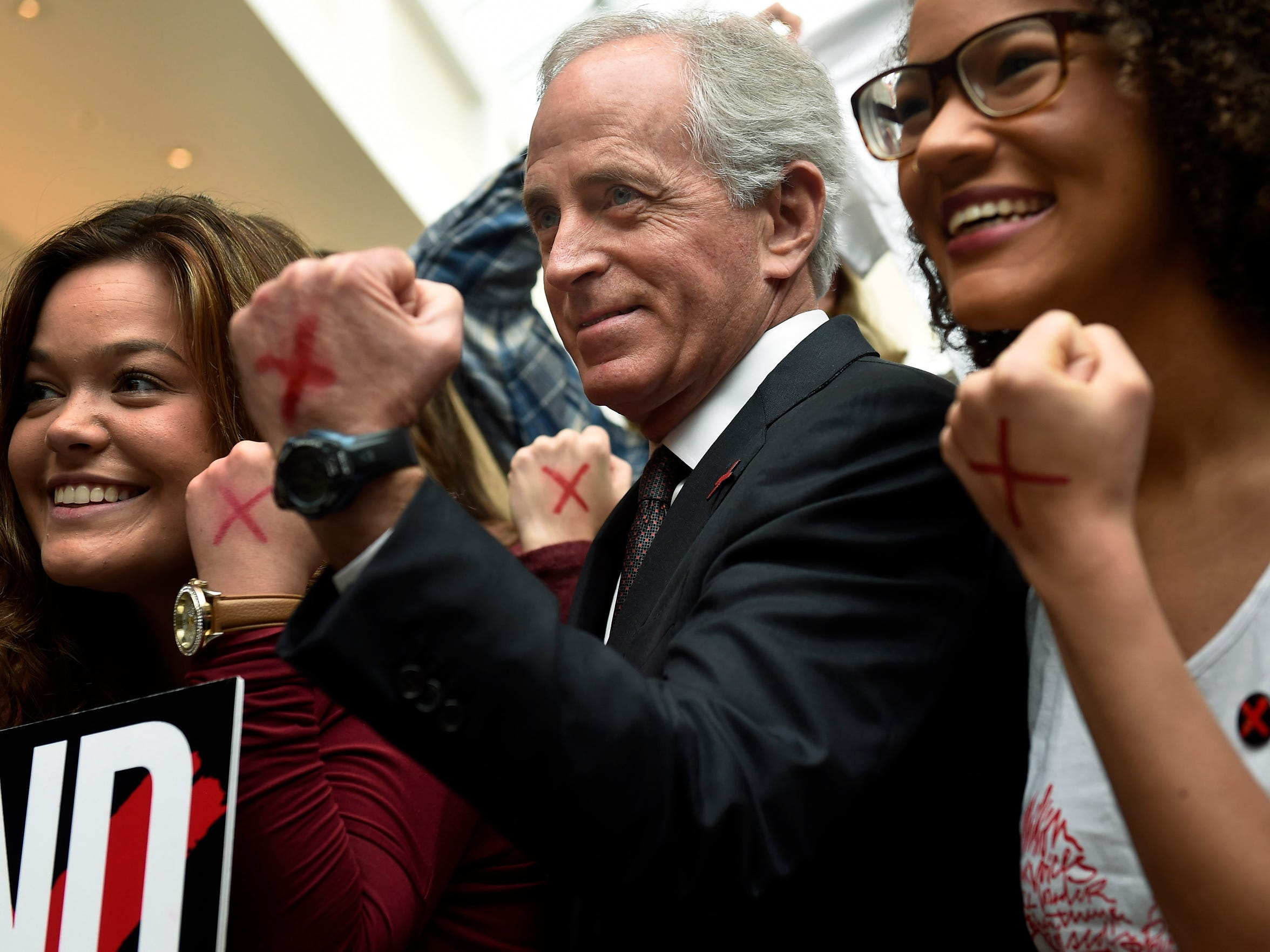 Sen. Bob Corker and others show the red X's on their hands in the effort to end human trafficking.