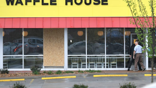 A window is boarded up at the Antioch Waffle House which remains closed Monday, April 23, 2018 after four people were shot and killed by a gunman early Sunday morning in Nashville, Tenn. The suspect is still at large.