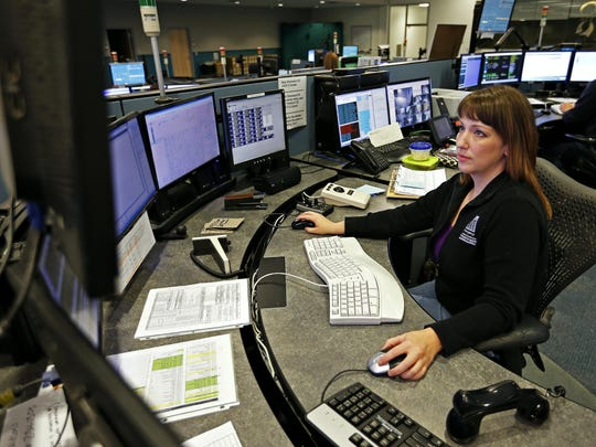 Kristina Webster, emergency dispatch supervisor, transfers an emergency call during the overnight shift at the Springfield Greene County 911 Emergency Communications Department in Springfield.