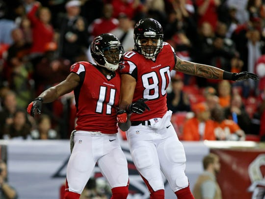 Falcons wide receiver Julio Jones (11) and tight end