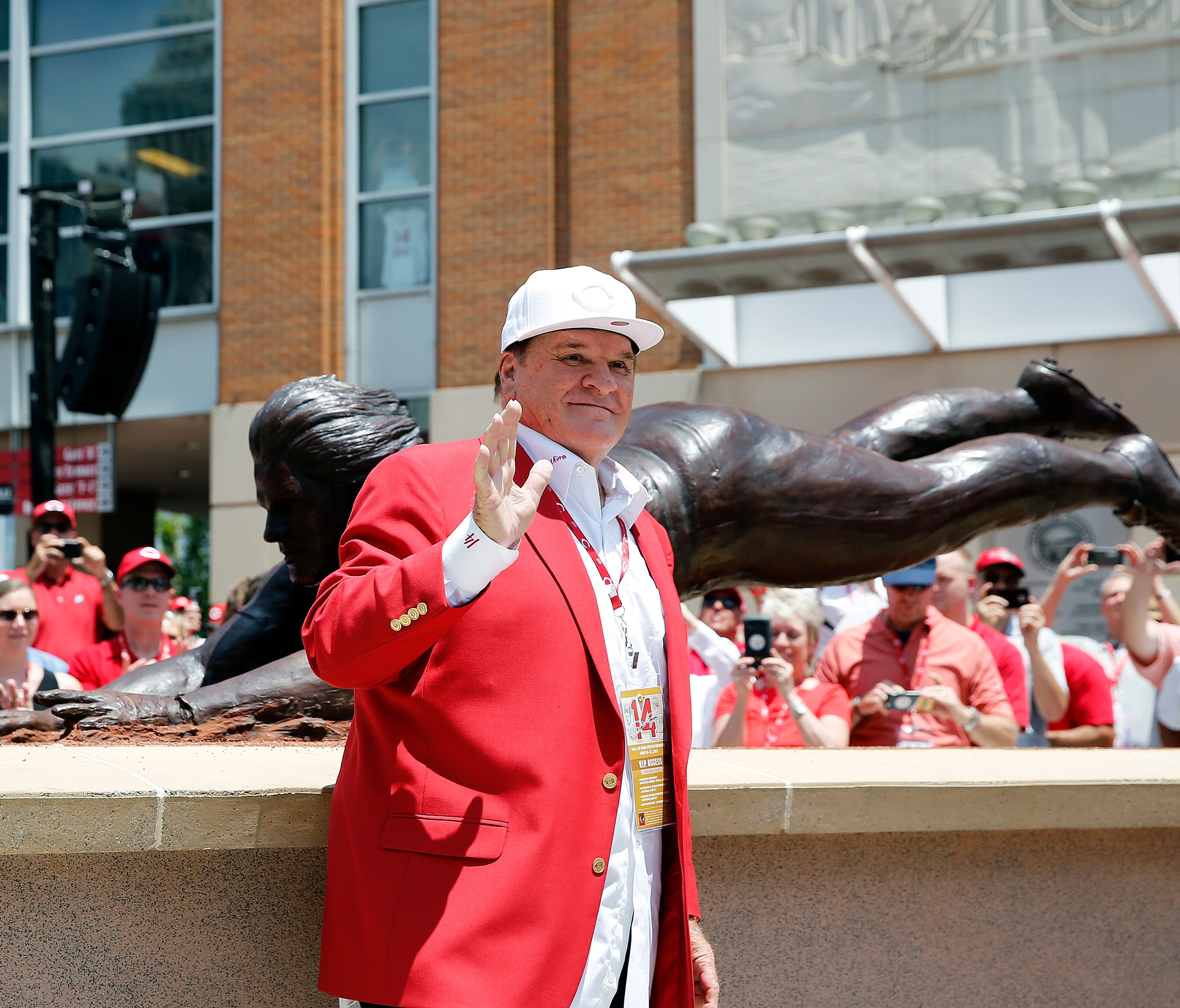 Pete Rose waves to his fans during the unveiling for a bronze statue dedicated to him at Great American Ball Park Saturday June 17, 2017.
