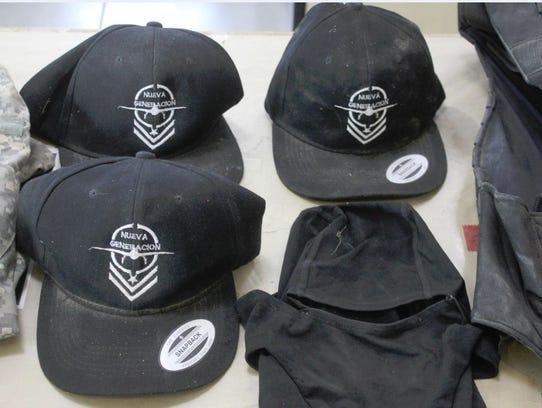 Caps with a Nueva Generacion logo were found along
