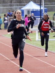 Breana Gambrell of Athens runs to a win in the 200-meter dash in April at the Waite-Molnar Invitational at Ernie Davis Academy in Elmira.