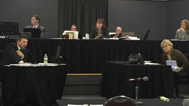 Soil scientist Aaron DeJoia, at bottom left, testifies before the Iowa Utilities Board Wednesday about the impact construction of the proposed Bakken oil pipeline on Iowa farmland. The board is conducting its proceedings at the Boone County Fairgrounds Community Building in Boone.