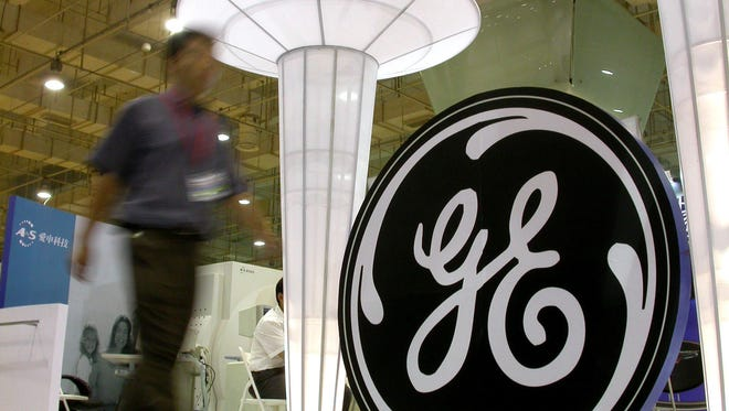 The General Electric logo is displayed at a booth in a 2006 expo held in Qingdao, China.