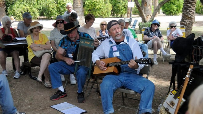 Jeff Elliott and Pat Cool play folk music at the Glendale Folk and Heritage Festival 2012 in Sahuaro Ranch Park in Glendale.