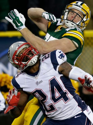 Packers receiver Jordy Nelson and Patriots cornerback Darrelle Revis battle for a ball in the end zone. Revis was called for interference on the play.