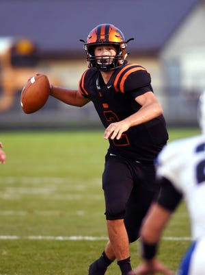 Ridgewood quarterback Kolton Alexander looks for an open receiver against Buckeye Trail.
