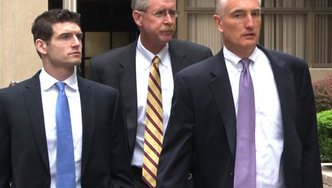 Lawyer Samuel Moultrie, from left, former Wilmington Trust chief credit officer William B. North and lawyer David E. Wilks arrive for a hearing at the J. Caleb Boggs Federal Building in Wilmington on May 21. Authorities allege the bank and officials hid the condition of the loan portfolio during the banking crisis.