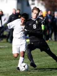Ithaca's Teo Levitan Amstrong collides with McQuaid