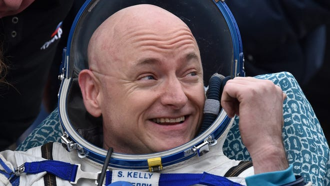 International Space Station (ISS) crew member Scott Kelly of the U.S. reacts after landing near the town of Dzhezkazgan, Kazakhstan, on March 2, 2016.