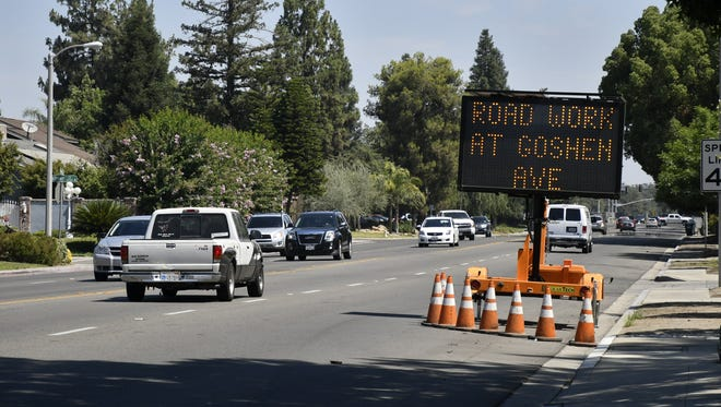 A sign on Demaree Street near Goshen Avenue alerts drivers of the start of road construction, scheduled for July 9, on Friday, July 6, 2018.